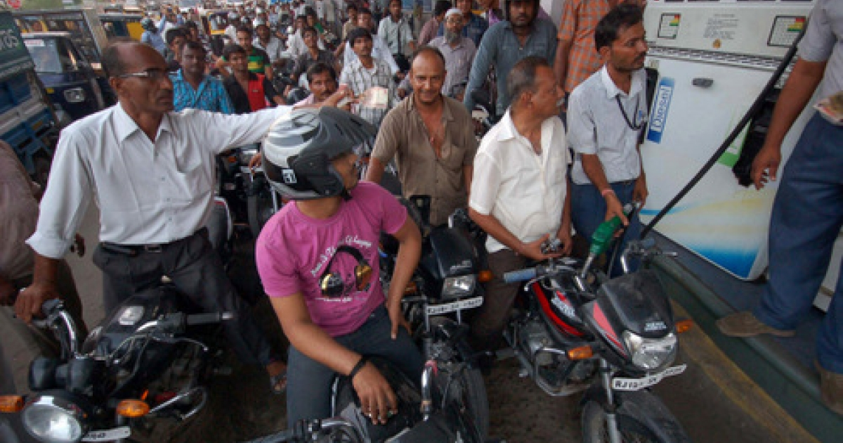 A crowd of motor-cyclists queue at a petrol pump to fill their vehicles after the announcement of a 7.50 Indian rupee price hike in petrol by the government in Jodhpur on May 23, 2012.  Indian state-run oil firms Wednesday announced the sharpest hike in petrol prices in nearly a decade to offset growing losses caused by subsidised rates, rises in the international oil price and a plunging rupee.  The increase was put at 6.28 Indian rupees (11 US cents) per litre which, when taxes are included, will mean a 7.5-rupee hike for consumers in cities such as New Delhi.</p>