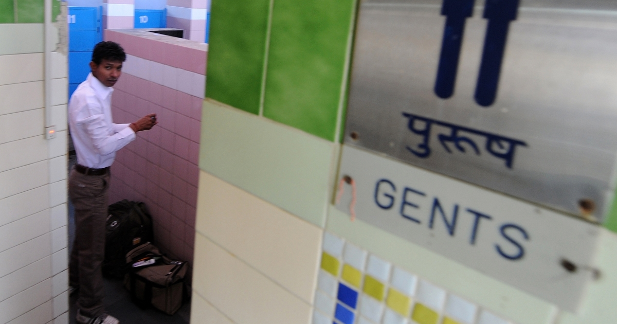 An Indian transit passenger gets ready in a toilet complex run by an NGO Sulabh International at railway station in New Delhi on April 23, 2011. Fast-growing Asian economies may be flush with money but filthy toilets remain a blight across the region despite rising standards of living, with dire effects on economies and public health.</p>
