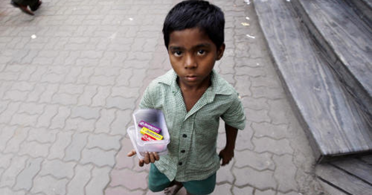 An Indian street child sells chewing gum outside a shopping plaza in Kolkata. In a bid to fight hunger, the worst evil of such poverty, the government on Friday introduced a bill to provide subsidized food grain to two-thirds of the population. Critics say the plan will cause distortions in the commodities market and result in a disastrous increase in the deficit. But proponents say no cost is too great.</p>