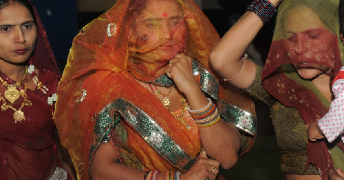 Indian relatives prepare to take part in celebrations on the eve of a mass marriage of prostitutes in the village of Vadia, some 210kms north of Ahmedabad late March 10, 2012.    Eight young women whose mothers are sex workers were married in a so-called