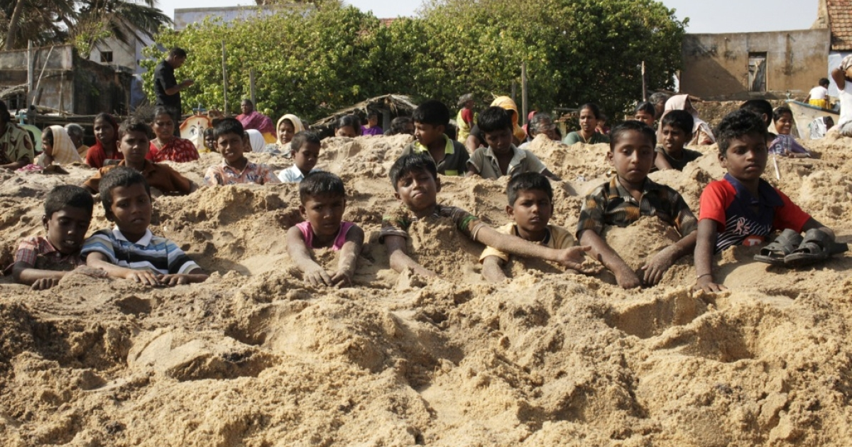 Indian anti-nuclear activists bury themselves in sand as part of a protest, demanding that uranium fuel stop being loaded in the nuclear reactor of Koodankulam Nuclear Power Project (KKNPP) on the beach at Idinthakarai village in southern Tamil Nadu on September 26, 2012.</p>