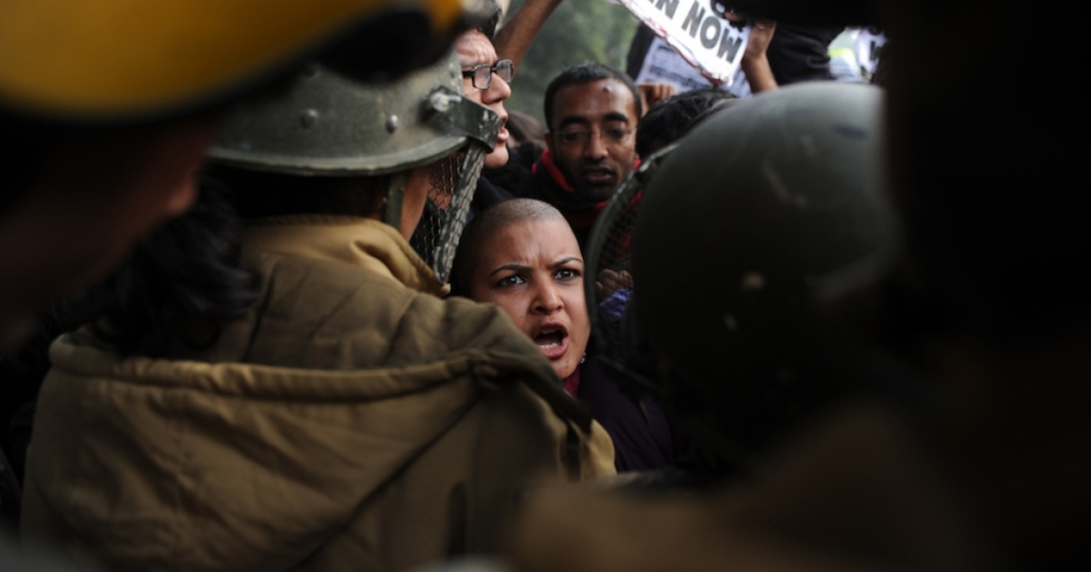 Indian demonstrators shout slogans and wave placards as they move towards India Gate in New Delhi on December 27, 2012, during a protest calling for better safety for women following the rape of a student in the Indian capital. Three of the five men accused of gang rape and attempted murder will plead not guilty.</p>