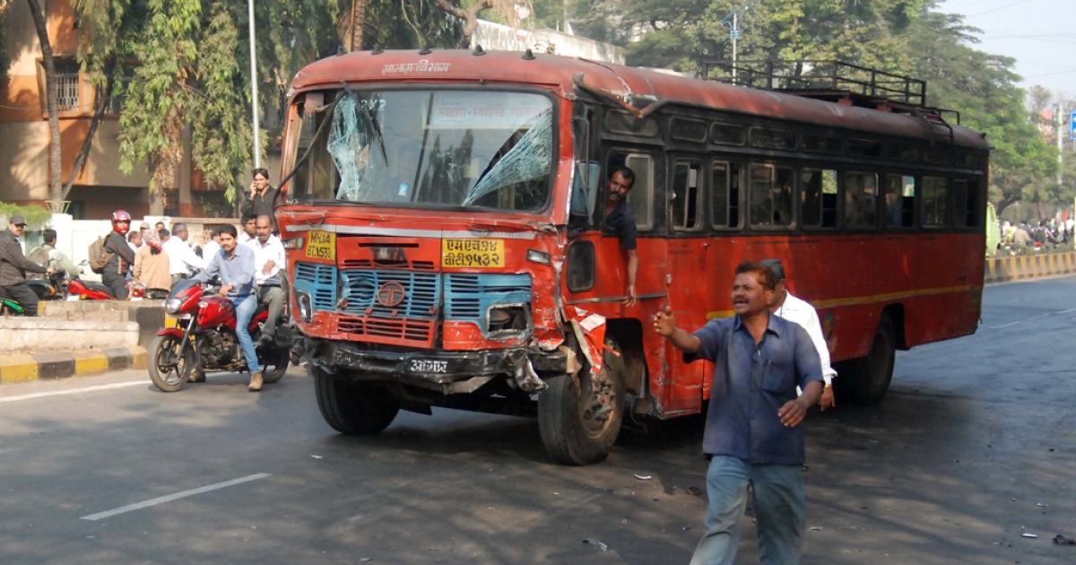 A man drives a bus involved in an accident after nine people were killed and dozens hurt when the bus went on the rampage, leaving a trail of smashed cars and crushed pedestrians, police said in Pune on January 25, 2012.</p>