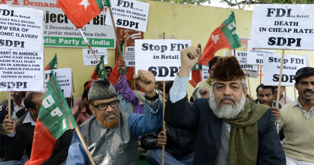 Supporters and activists of the Social Democratic Party of India protest against the Indian government's decision to allow foreign direct investment (FDI) in the retail market during a rally in New Delhi on December 5, 2012.</p>