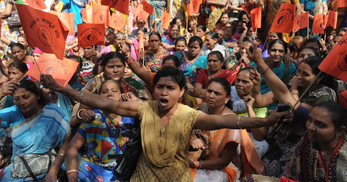 Members of trade unions participate in a rally during a nationwide strike in Ahmedabad on February 28, 2012. A nationwide strike called by trade unions including those affiliated with the government hit Indian cities Tuesday, as millions joined the call for tighter labour laws and a minimum wage.</p>