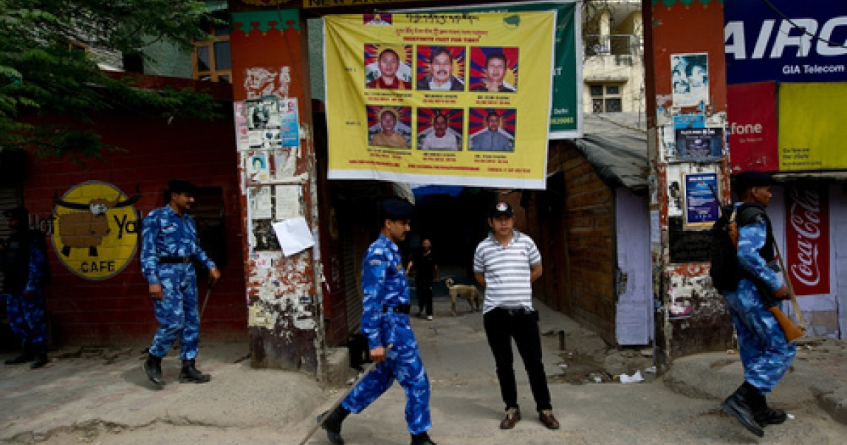 India put New Delhi's community of Tibetan exiles under collective house arrest Wednesday, implementing a rarely used legal provision, after a Tibetan demonstrator set himself on fire outside the parliament building to protest the visit of Chinese President Hu Jintao. Hu will attend the BRICS Summit on Thursday and hold separate bilateral talks with Indian Prime Minister Manmohan Singh.</p>