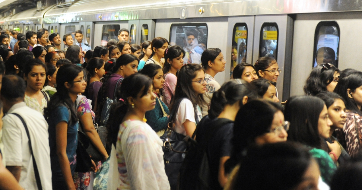 Indian commuters wait to travel at a Delhi Metro station in New Delhi on July 28, 2012. Over two million  passengers Travel by Delhi metro and  2500 train trips are made each day.</p>