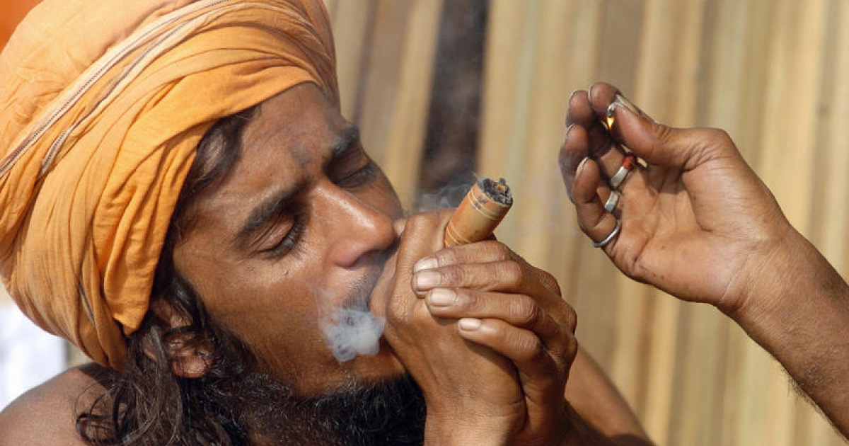 An Indian Sadhu (Hindu holy man) smokes marijuana in Kolkata, 10 January 2006.</p>