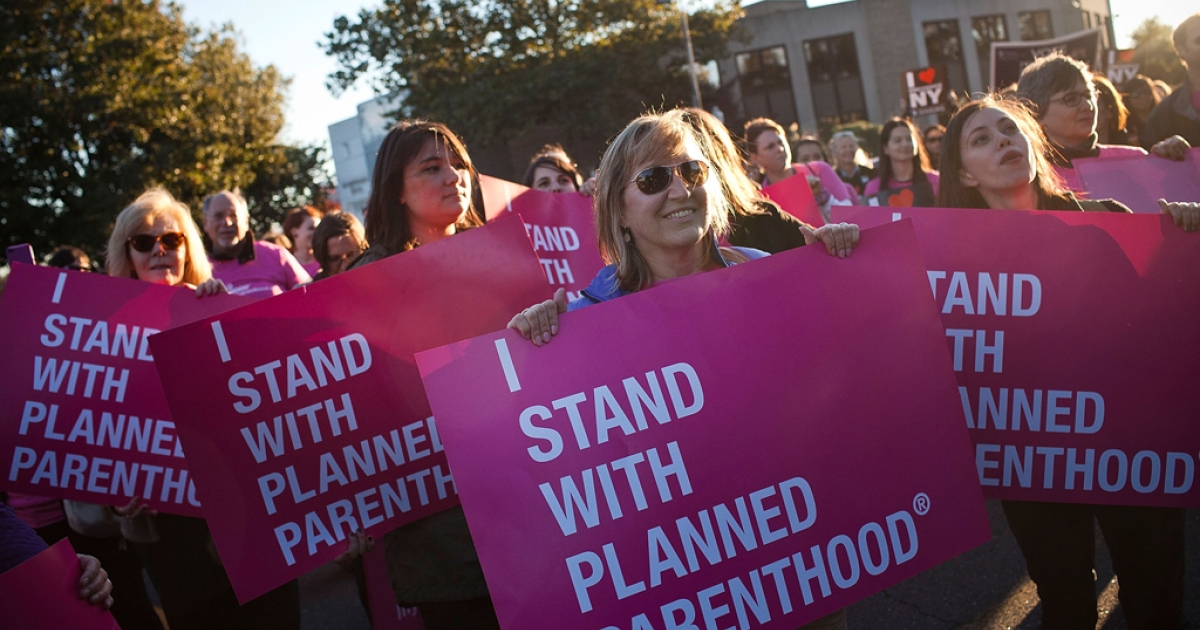 Women protest for continued funding of Planned Parenthood outside Hofstra University prior to the second presidential debate on October 16, 2012 in Hempstead, New York. Wisconsin Gov. Scott Walker signed a controversial abortion bill Friday. Planned Parenthood said that the new law will force two of the state's four clinics to close.</p>