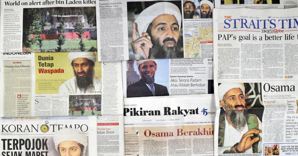 Newpaper headlines portray the killing of Osama Bin Laden, taken in Jakarta on May 3, 2011.</p>