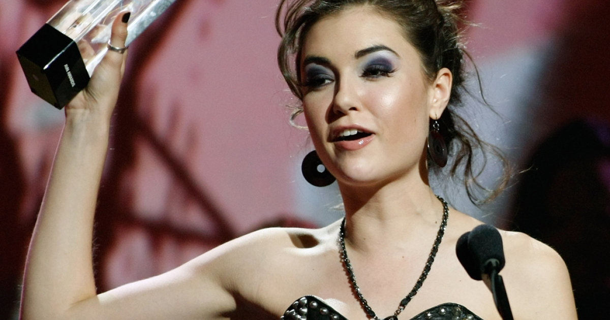 Adult film actress Sasha Grey accepts an award during the 27th annual Adult Video News Awards Show in Las Vegas, Nevada on Jan. 9, 2010.</p>