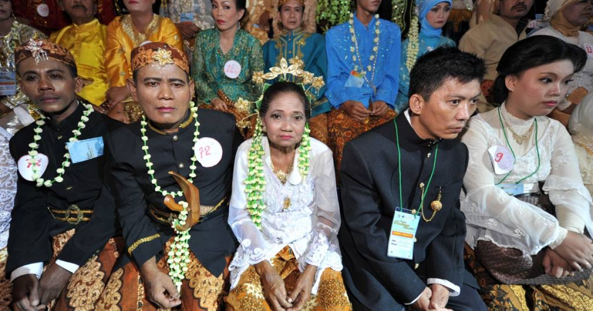More than 4,000 couples marry in a mass ceremony in Indonesia, sidestepping costly administration fees.</p>