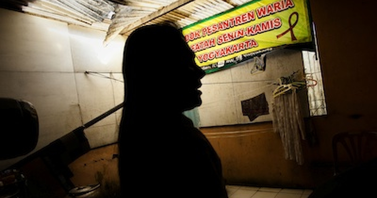 A transgender named Novi waits at Transgender Koran School on July 29, 2011 in Yogyakarta, Indonesia.</p>