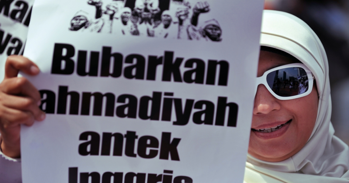 A protester hold a placard, reading