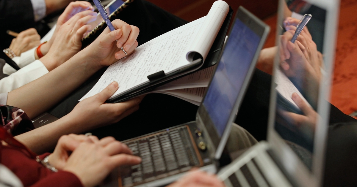 WASHINGTON, DC - JANUARY 19:  Reporters use laptop computers, iPads and ink and paper to take notes during a panel discussion organized by NetCoalition about the Protection IP Act (PIPA) and the Stop Online Privacy Act (SOPA) at the U.S. Capitol January 19, 2012 in Washington, DC. Opposed to SOPA and PIPA in their current forms, NetCoalition is a lobying group representing Internet and technology companies, including Google, Yahoo!, Amazon.com, eBay, IAC, Bloomberg LP, Expedia and Wikipedia.  (Photo by Chip Somodevilla/Getty Images)</p>
