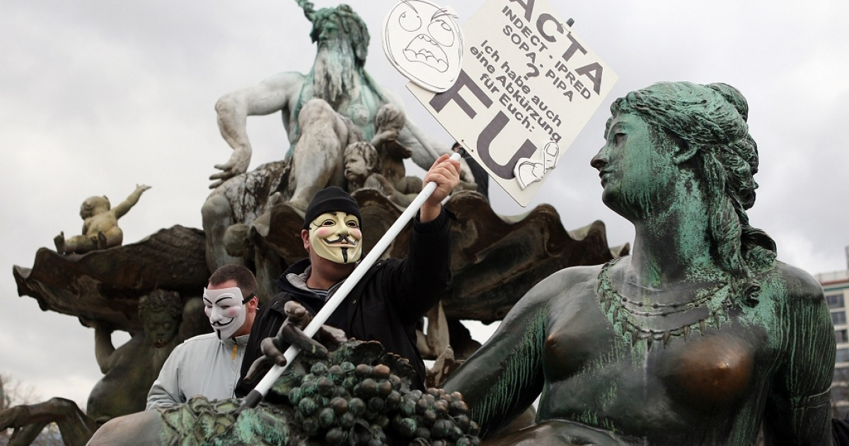 Activists protest during a demonstration against the Anti-Counterfeiting Trade Agreement (ACTA) on February 25, 2012 in Berlin, Germany. ACTA is a proposed treaty attempting to establish an international governing body with legal standards intended to protect intellectual property and prevent the production and sale of counterfeit goods. The German government has delayed a decision on the agreement, citing concerns by the Justice Ministry, and according to news reports is waiting for approval by the European Parliament prior to signing the multinational treaty.</p>