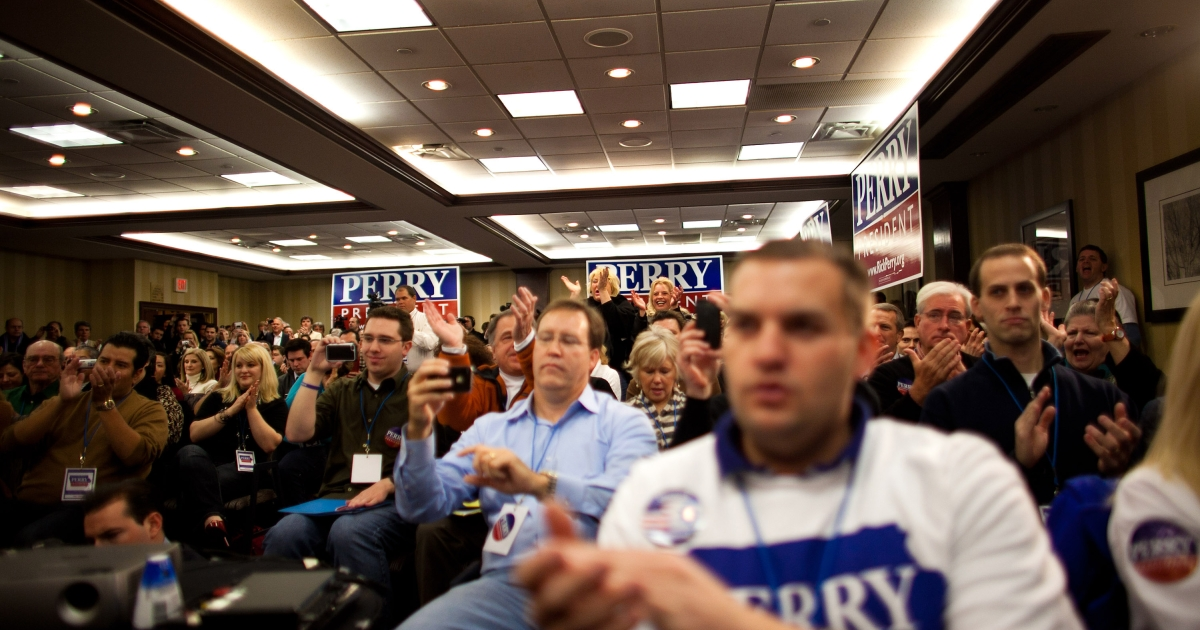 Supporters cheer while Republican presidential candidate, Texas Gov. Rick Perry speaks with potential voters during a caucus training session held at the Sheraton January 3, 2012 in West Des Moines, Iowa. After months of campaigning by candidates, Iowan voters throughout the state prepare to participate in the first caucus of the 2012 presidential election.</p>