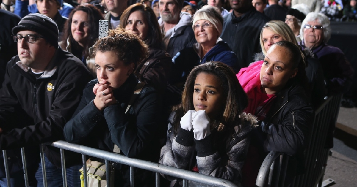 Diverse support: A crowd at a rally for Barack Obama Des Moines, Iowa, listens intently to the president the day before Election Day.</p>