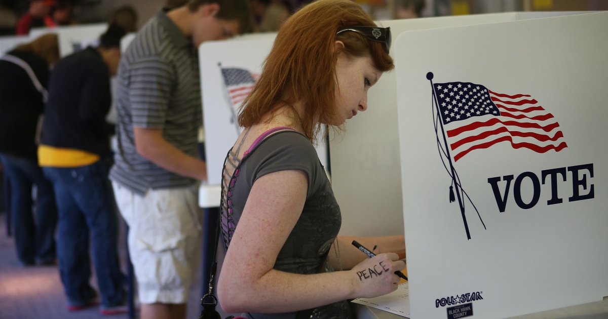 Student Courtney Johnson votes on the campus of the University of Northern Iowa on Sept. 28, 2012 in Cedar Falls, Iowa. Voters filled the polling place which had been set up on campus for early voting following a nearby rally with first lady Michelle Obama.</p>