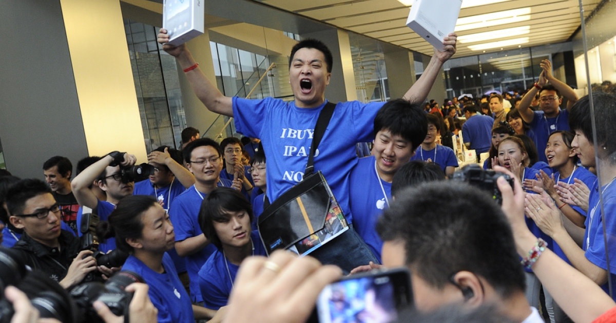 Apple customer Han Ziwen shouts holding his ipads outside Apple's flagship store in Beijing after queuing for 60 hours to be one of the first to officially buy an iPad in China. September 17, 2010.</p>