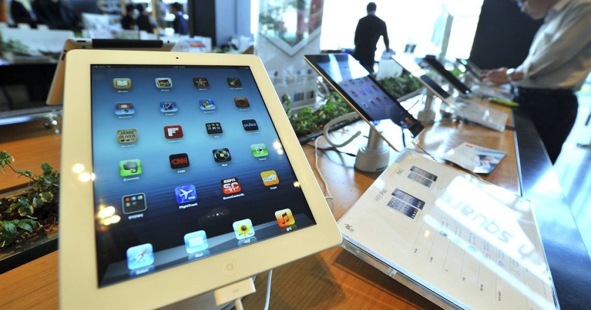 Apple's new iPad is displayed at a Korean distributor of iPhones and iPads, in Seoul on April 20, 2012.</p>