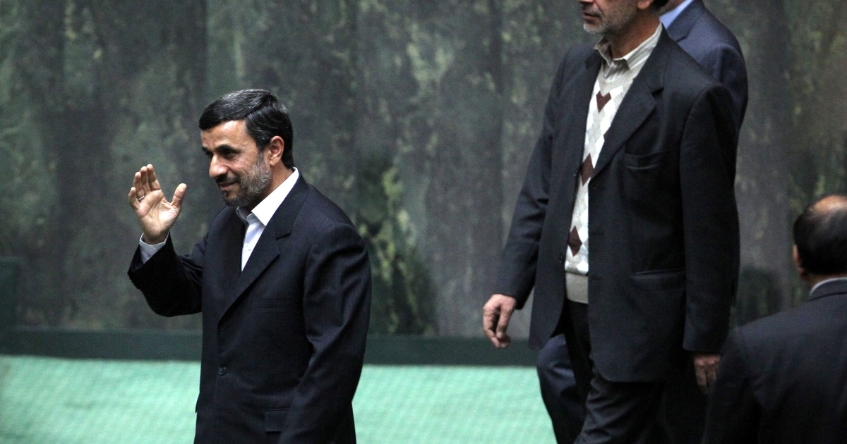 Iranian President Mahmoud Ahmadinejad (L) arrives to attend a parliamentary session on November 1, 2011 in Tehran.</p>