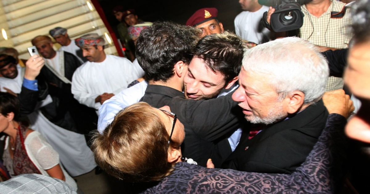 American hiker Josh Fattal (C) is greeted on September 21, 2011 in Muscat, Oman, after Tehran released him and Shane Bauer on bail, months after handing them an eight year jail term. The pair was released earlier September 21, 2011 from Tehran's notorious Evin prison, after more than two years in jail for spying and illegal entry into Iran, after the Gulf sultanate of Oman paid their bail.</p>