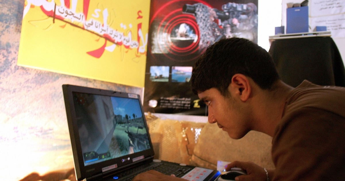 A Lebanese boy plays the computer game 'Special Force 2', inspired by last summer's war between Israel and Hezbollah, in a southern suburb of Beirut 23 August 2007. The computer game puts players in the role of a Hezbollah fighter on the frontline of war with Israel, simulating raids into Israel to capture soldiers, battling tank movements in the valleys of south Lebanon and launching Katyusha rockets at Israeli towns.</p>