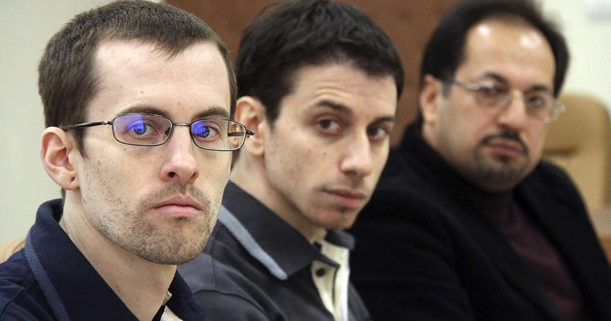 A picture released by Iran's state-run Press TV shows US hikers Shane Bauer (L) and Josh Fattal (C), detained in Iran on spying charges, sitting next to an unidentified translator during the first session of their trial at the Tehran Revolutionary Court in the Iranian capital on February 6, 2011, more than 18 months after their arrest on the unmarked border with Iraq during a hiking trip.</p>