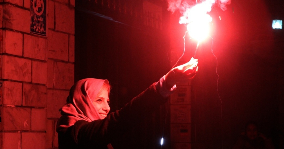 An Iranian woman holds a firecracker in Tehran on March 13, 2012 before the Spring holiday of Nowruz. While Nowruz is often a time for Iranians to travel abroad, this year economic sanctions, a devalued currency and international tensions are keeping them home.</p>