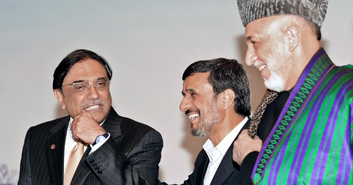 Pakistan President Asif Ali Zardari (L), Iran President Mahmoud Ahmedinejad (C) and Afghanistan President Hamid Karzai (R) chat after a meeting in Istanbul on Dec. 23, 2010.</p>