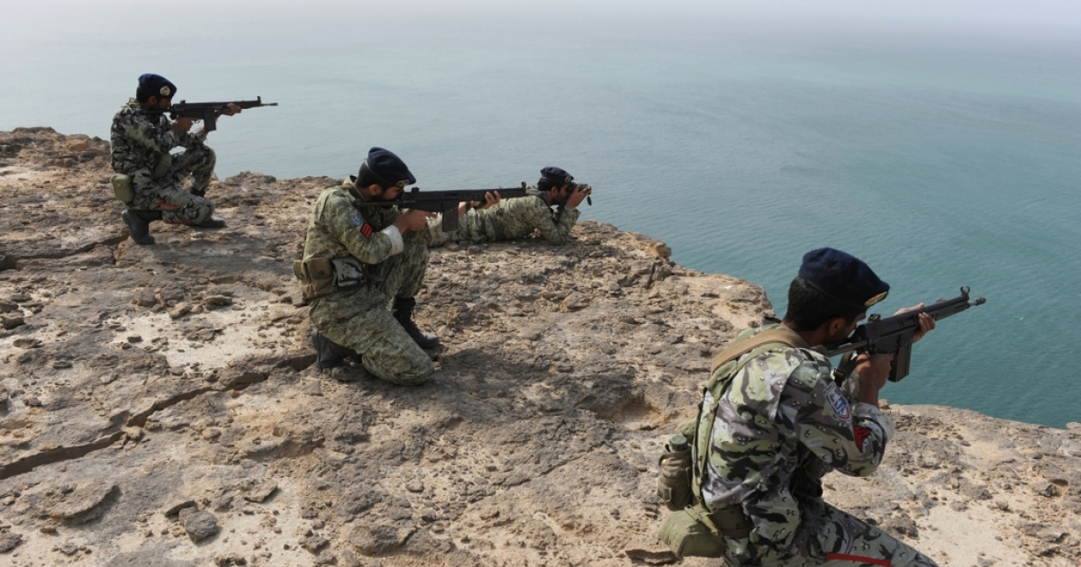 Iranian Soldiers aim during navy exercises in the Sea of Oman near the Iranian port of Bandar Jask, in southern Iran on Dec. 30, 2011.</p>