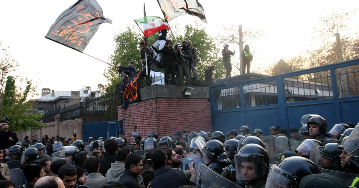 Iranian protesters storm the British Embassy in Tehran, November 29, 2011. Police dispersed the crowd with tear gas.</p>