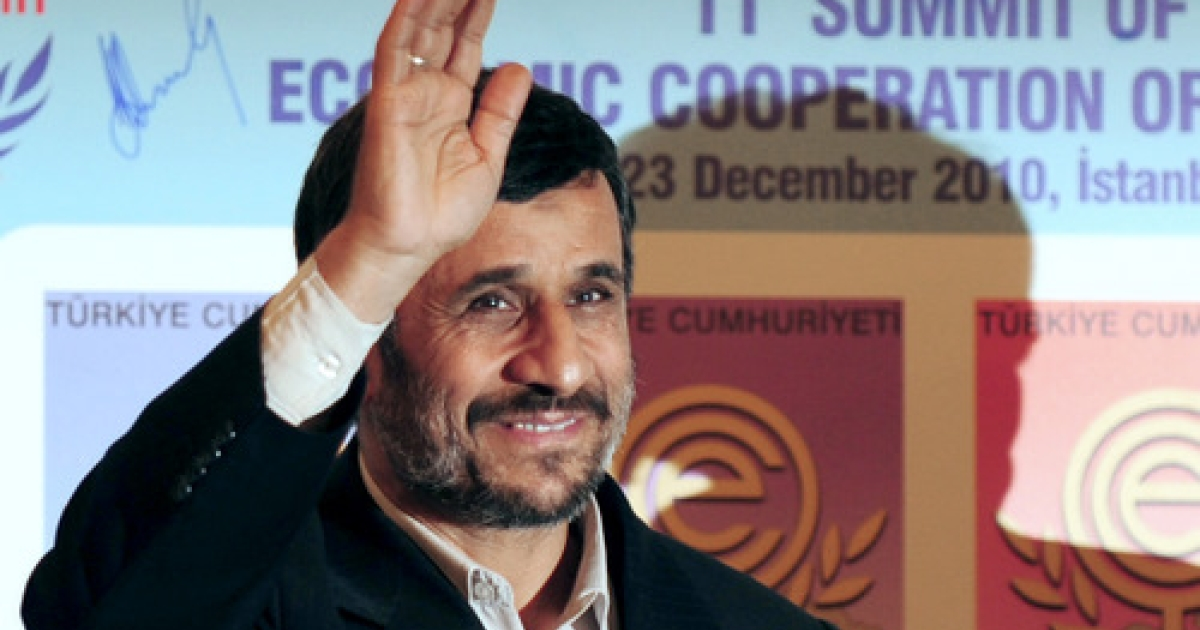 Iran's President Mahmoud Ahmedinejad waves before a family photo after the 11th Economic Cooperation Organization (ECO) Summit in Istanbul, on December 23, 2010.</p>