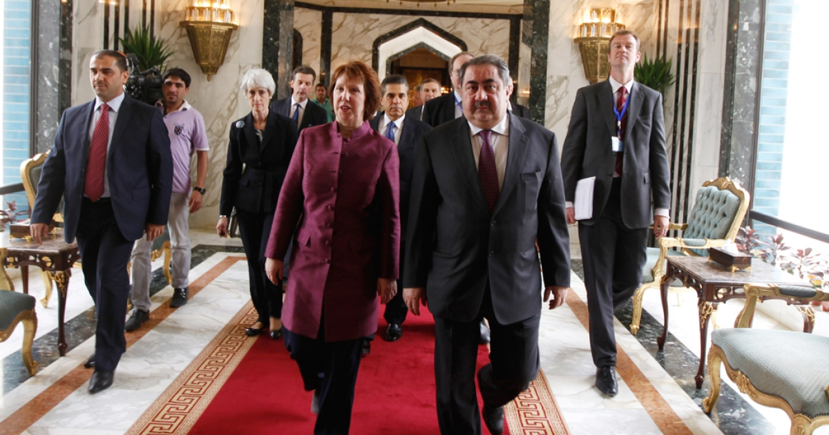 European Union Foreign Policy Chief Catherine Ashton of the UK (front L) walks with Iraq's Foreign Minister Hoshyar Zebari before their meeting on May 23, 2012 in Baghdad, Iraq. Representatives from the P5+1 group of nations are meeting in Baghdad to hold talks aimed at persuading Iran to suspend their nuclear program.</p>