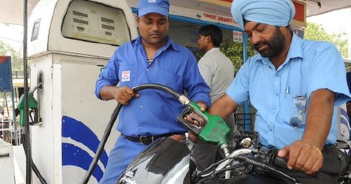 An Indian petrol pump employee fills the tank of a motorbike at a petrol station in Amritsar on July 7, 2011. India imports about 80 percent of its crude oil and has been frantically seeking new fuel sources as its economy grows.</p>