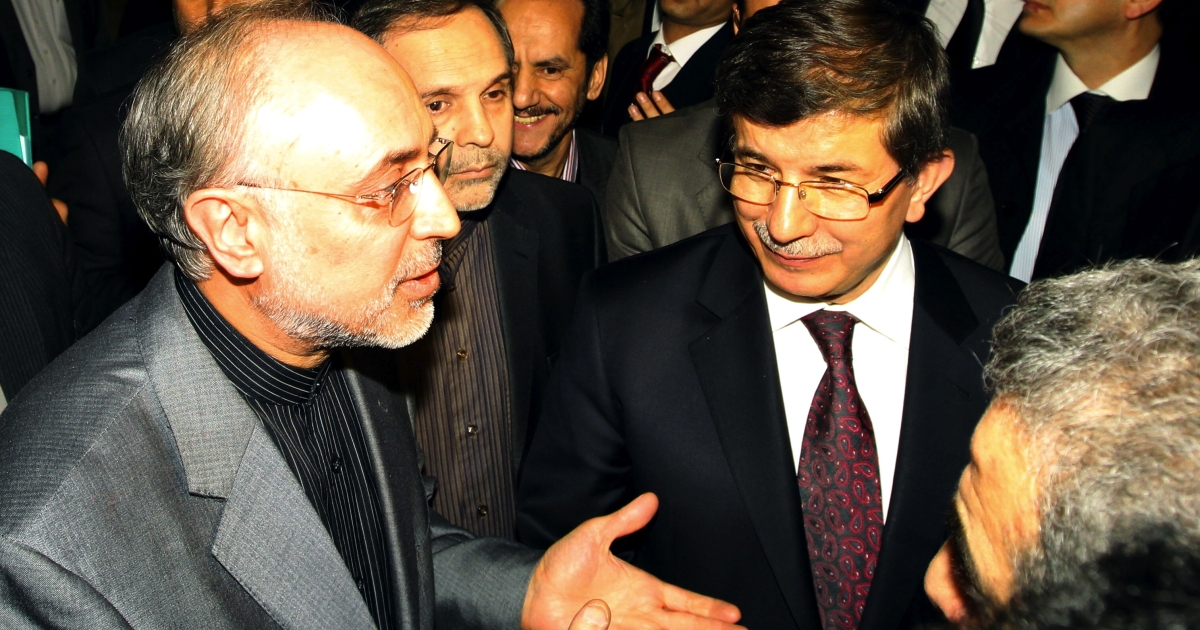 Iranian Foreign Minister Ali Akbar Salehi (L) and his Turkish counterpart Ahmet Davutoglu (R) talk to journalists before a meeting in Tehran on January 4, 2012. The European Union and the United States tightened today the sanctions noose around Iran, with diplomats in Brussels saying a preliminary agreement had been reached on an EU embargo of Iranian oil. The West's double squeeze on Iran adds to existing sanctions imposed over Tehran's nuclear programme that is increasingly destabilising the Islamic republic oil-dependent economy</p>
