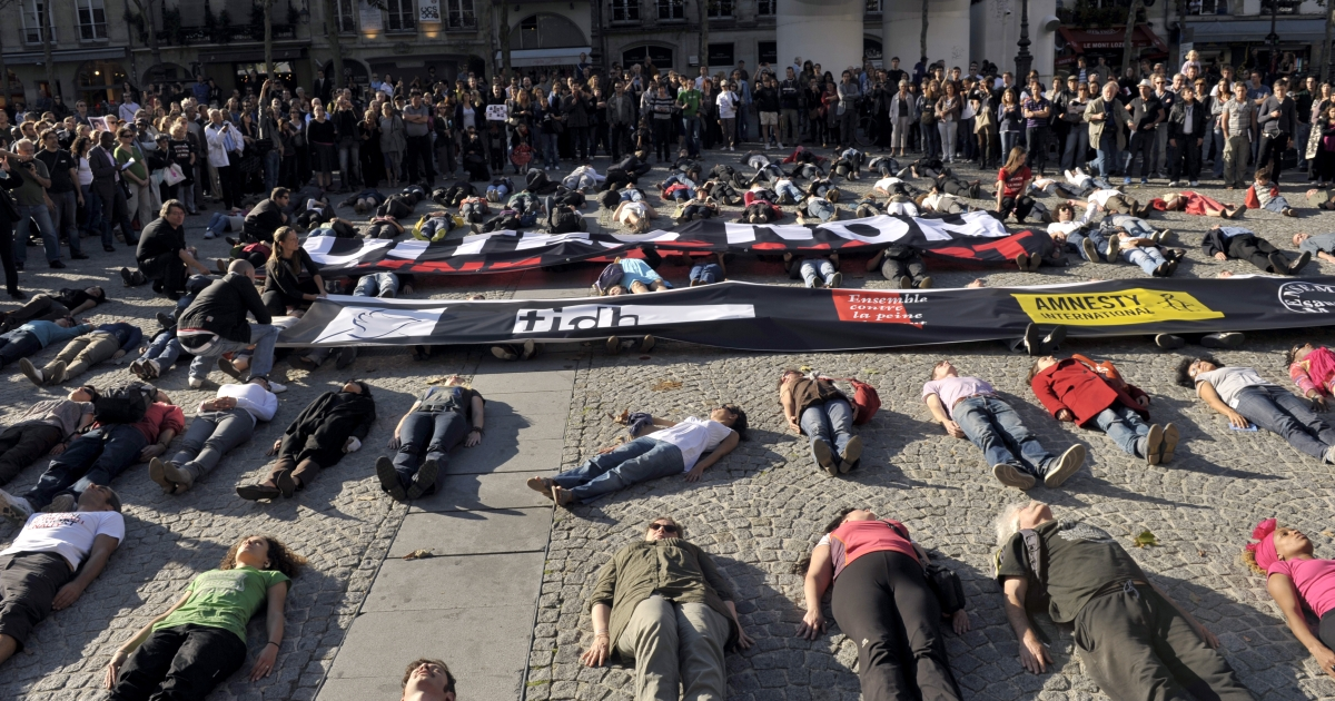 People lie on the ground during an October 2010 demonstration outside the Pompidou Center in Paris to protest against death penalty.</p>