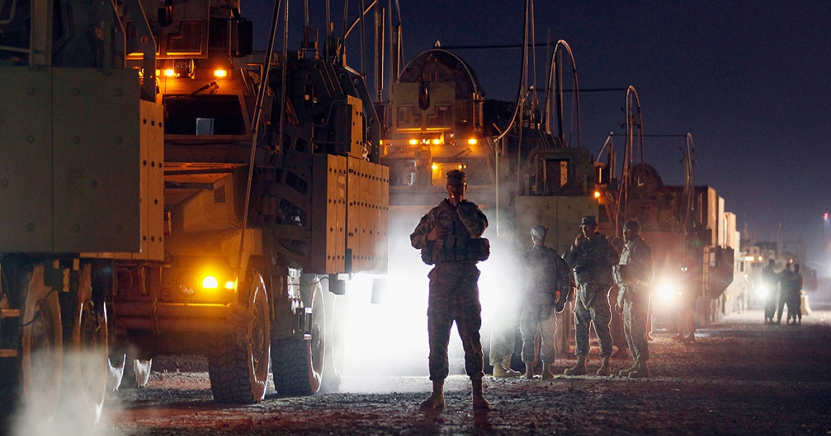 U.S. Army soldiers from the 2-82 Field Artillery, 3rd Brigade, 1st Cavalry Division, wait to load onto their armored vehicles as they prepare to convoy to Kuwait from Camp Adder in Iraq on December 7, 2011 at Camp Adder, near Nasiriyah, Iraq. After seven months in Iraq, the 3rd Brigade is pulling out of the country as part of America's military exodus by the end of December after eight years of war and occupation which included the overthrow of Saddam Hussein.</p>