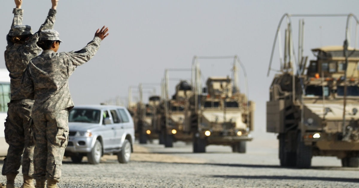 Soldiers wave to colleagues as a section of the last American military convoy to depart Iraq from the 3rd Brigade, 1st Cavalry Division arrives after crossing over the border into Kuwait on December 18, 2011 in Camp Virginia, Kuwait. At least 4,485 U.S. military personnel died in service in Iraq. According to the Iraq Body Count, more than 100,000 Iraqi civilians have died from war-related violence</p>