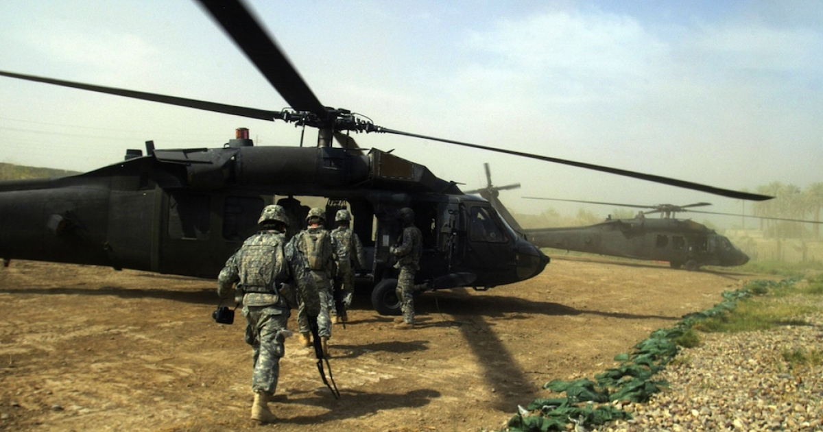President Barack Obama announced a withdrawal of U.S. troops from Iraq by the end of the year.  U.S. soldiers are shown here boarding a Blackhawk helicopter in Yussifiyah, south of Baghdad, on Oct. 15, 2008.</p>