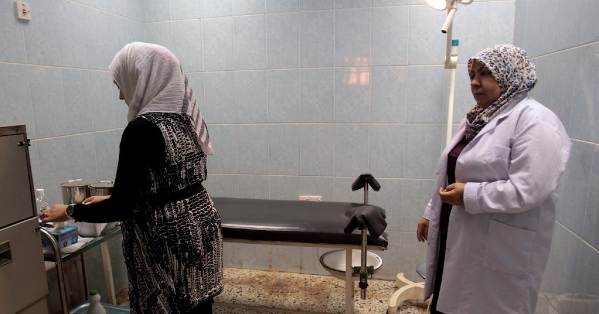 Female employees at Medical Legal Institute (MLI) in Baghdad check the equipment in the room where virginity tests are performed on June 28, 2012. Iraqi women face court-ordered virginity tests that often show they were virgins until marriage but shame them nonetheless.</p>