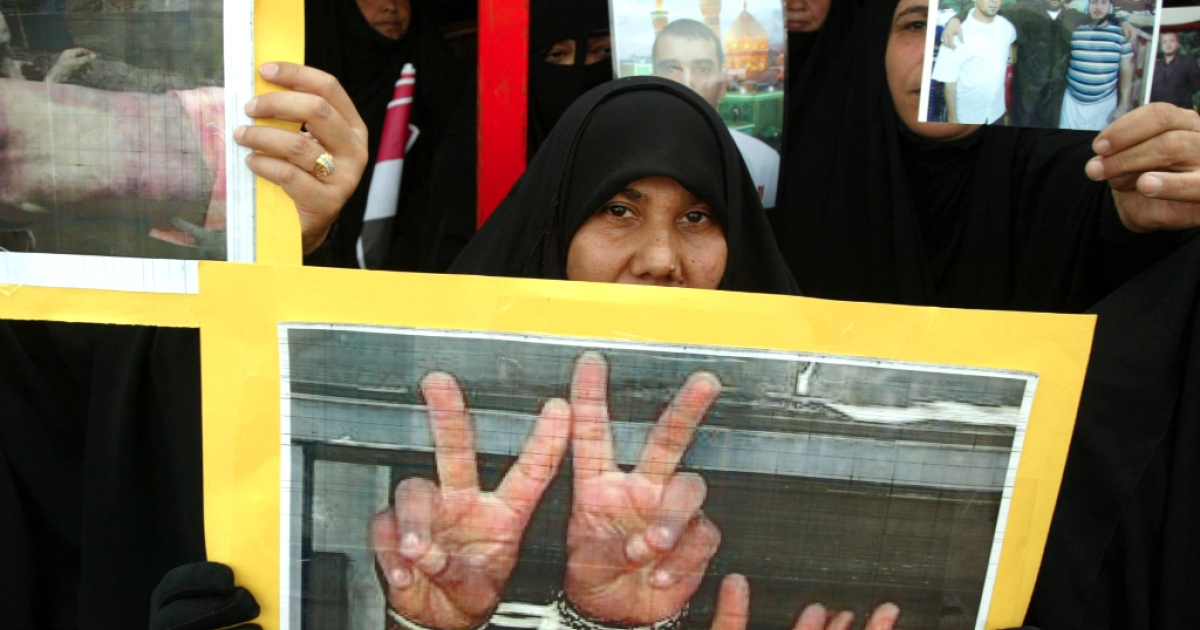 An Iraqi woman hold up a poster during a protest in central Najaf, 150 kms south of Baghdad on November 14, 2009. Some 800 Iraqis from all over the southern provinces gathered in Najaf to call on Iraqi Prime Minister Nuri al-Maliki cancel the death sentences passed on their jailed relatives and to release them.</p>