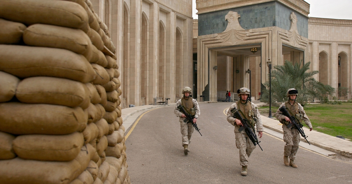 This photo shows US Marines walking past the front of the US Embassy in Baghdad, Iraq on Feb. 6, 2007. On Sept. 11, 2012, attacks on the US consulate in Benghazi, Libya killed Ambassador Christopher Stevens. Protestors also attacked and vandalized the US Embassy in Cairo.</p>