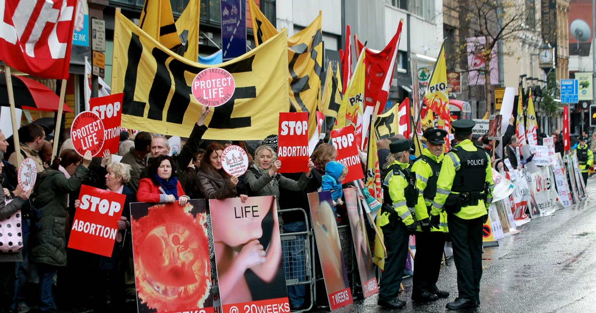 Abortion protesters holding up placards outside the Marie Stopes clinic, the first private clinic to offer abortions to women in Belfast, Northern Ireland, on Oct. 18, 2012.</p>