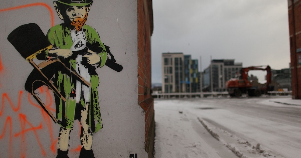A street artist's picture of a traditional Leprechaun is daubed on a wall of an empty building in the docklands area in Dublin on Dec. 1, 2010. The Irish economy has faltered after years of growth and EU finance ministers approved an aid package totaling 85 billion euros.</p>