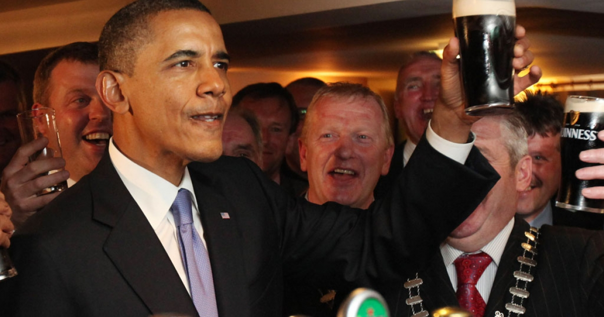 U.S. President Barack Obama enjoys a glass of Guinness in his ancestral home of Moneygall, Ireland, on May 23, 2001. On his one-day visit to Ireland, Obama met with distant relatives in Moneygall and spoke in Dublin.</p>