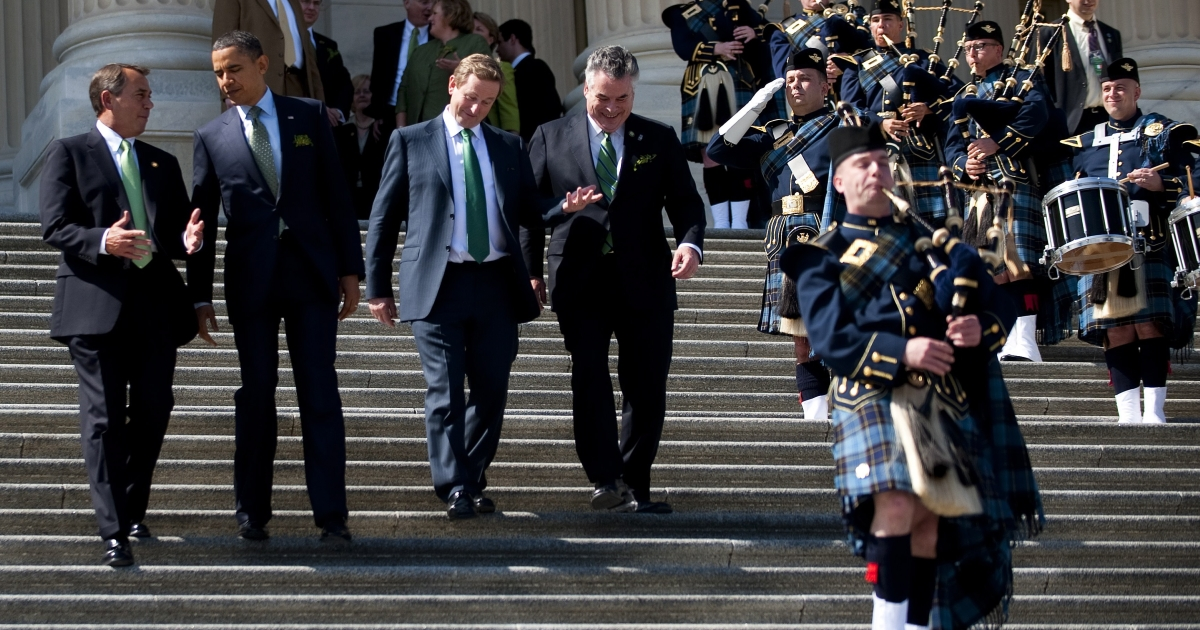 U.S. President Barack Obama (2nd L) walks with Speaker of the House John Boehner (L) and Irish Prime Minister Enda Kenny (C) after a St. Patrick's Day lunch at the Capitol building in Washington, DC, March 17, 2011.</p>