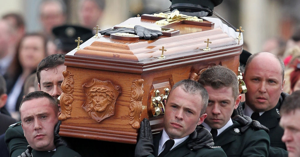 Police officers carry the coffin containing the remains of their colleague Police Constable Ronan Kerr to the church of the Immaculate Conception, in Beragh, Northern Ireland, on April 6, 2011.</p>
