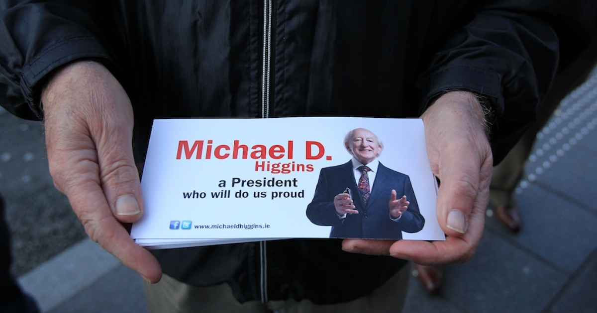 Michael D. Higgins looks set to become Ireland's next president.  In this photo a supporter hands out the presidential candidate's leaflets in Kilkenny on Oct. 25, 2011.</p>